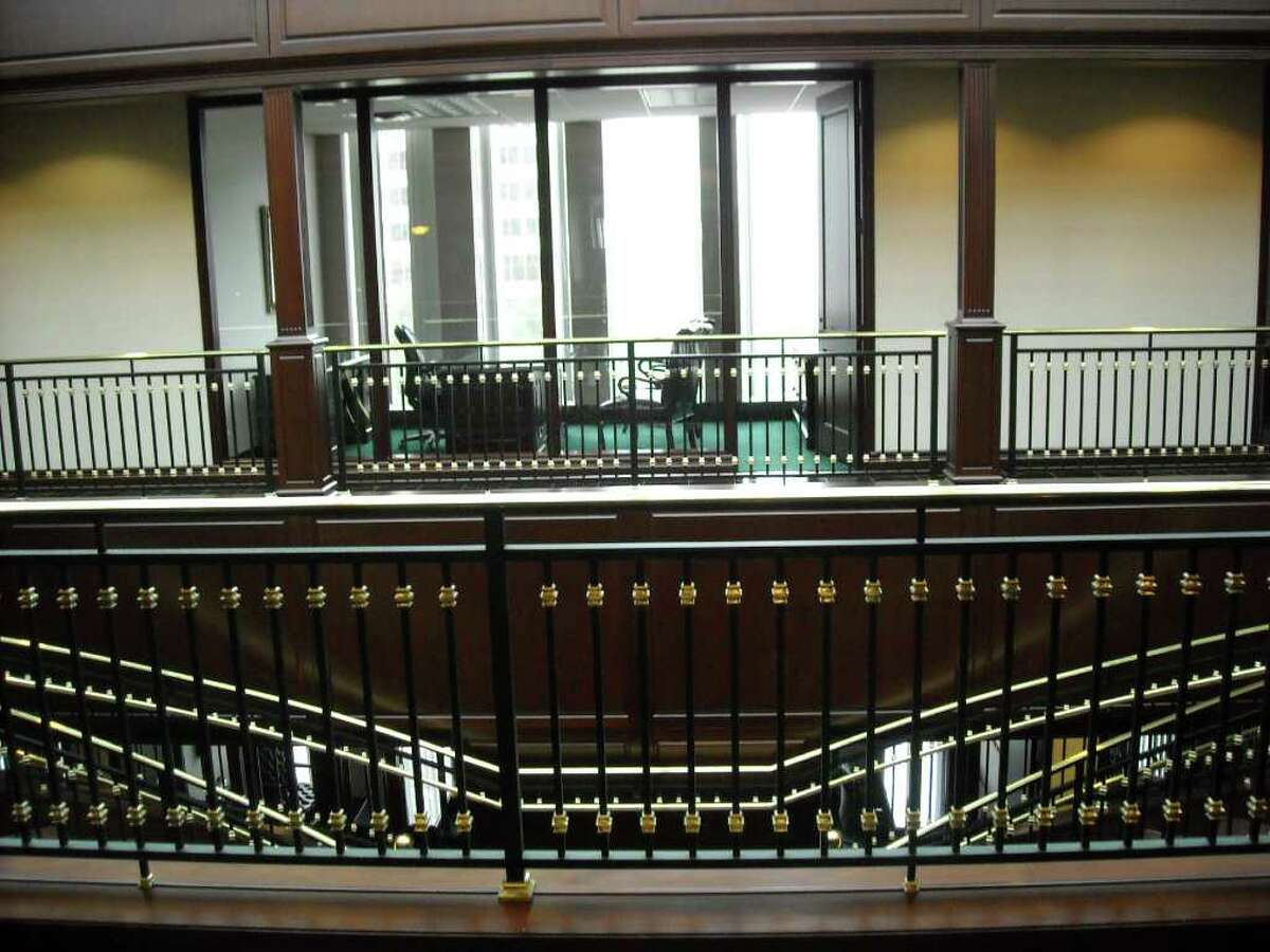 The grand stair case and railings are a focal point of the interior of the building that use to house offices of disgraced Stanford Financial Group.