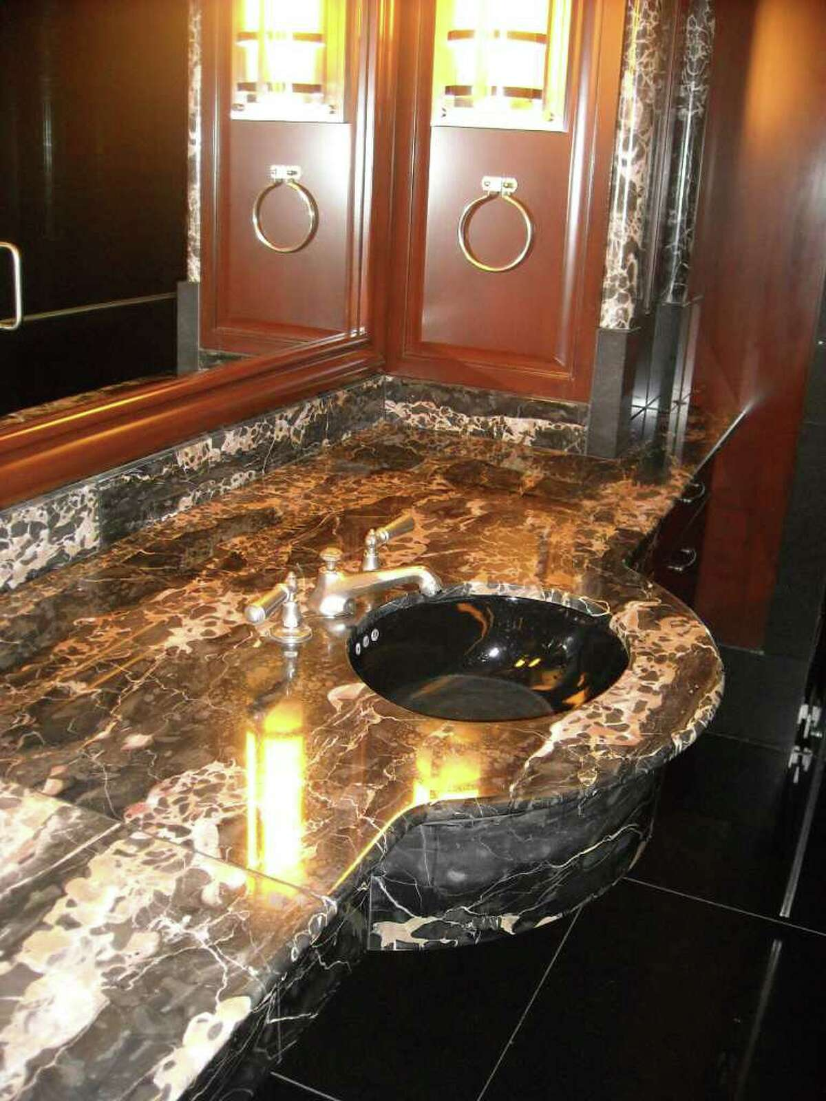 The executive sink in the bathroom of the private executive suite, which also has a shower and a closet, at the former headquarters of Stanford Financial Group.