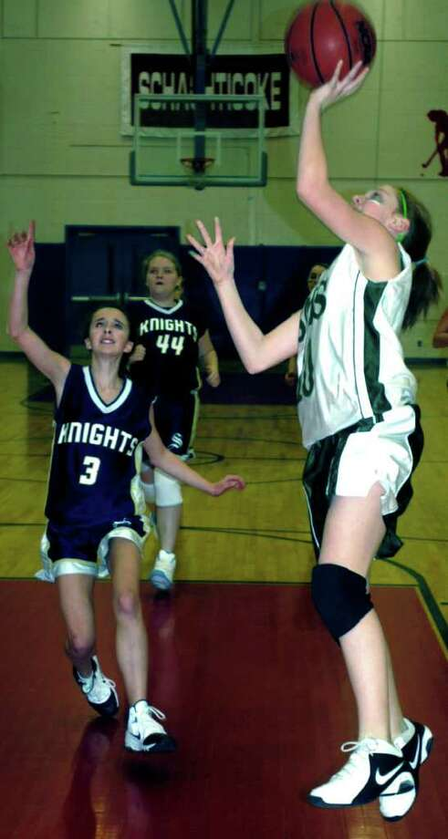 SPECTRUM/Allie Noteware of Schaghticoke Middle School girls' basketball vs. Sherman, Feb. 4, 2011 in New Milford Photo: Norm Cummings / The News-Times
