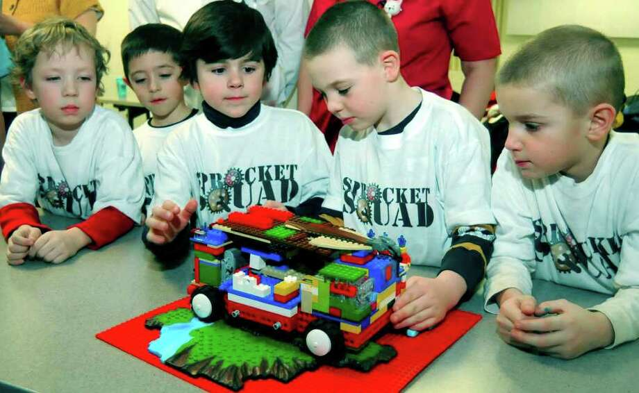 SPECTRUM/Five New Milford first-grade students in the Robotics Club call themselves The Sprocket Squad. For a  project on something that helps the body, the group has created a mobile hospital out of Legos. From left to right are Liam Cahalane, 6, Ryan Sarbello, 7, Jackie Colangelo, 6, Matt Crookshank, 6, and Joey LaCava, 6, shown Feb. 10, 2011 at New Milford Hospital. Photo: Lisa Weir / The News-Times Freelance