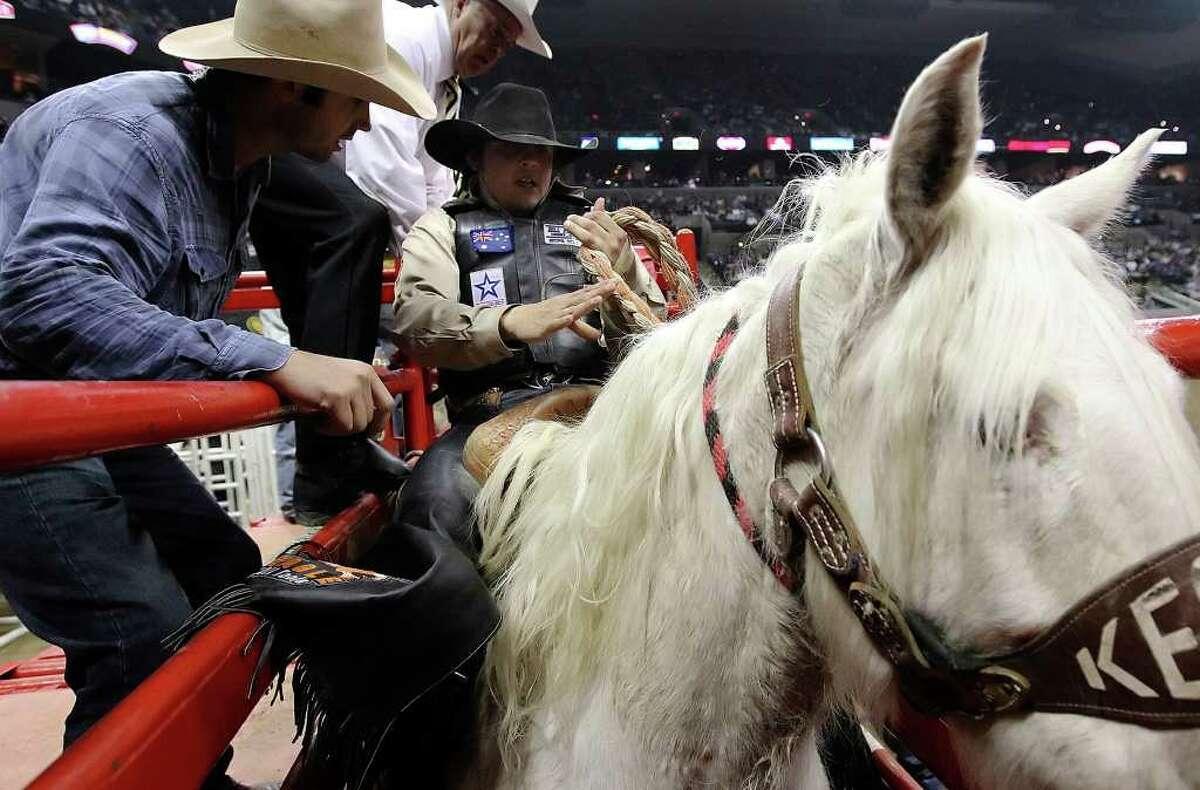 Sam Spreadborough prepares to ride in the saddle bronc event on Wednesday, Feb. 16, 2011, at the San Antonio Stock Show & Rodeo.