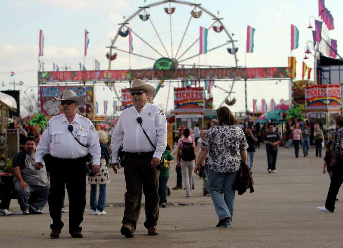 Bruce Simonds (left), investigator from the Bexar County Criminal District Attorney's Office, and Sgt. Rick Trevino, from Terrell Hills Police Department, make their rounds along the grounds of the 2011 San Antonio Stock Show & Rodeo on Wednesday, Feb. 16, 2011.