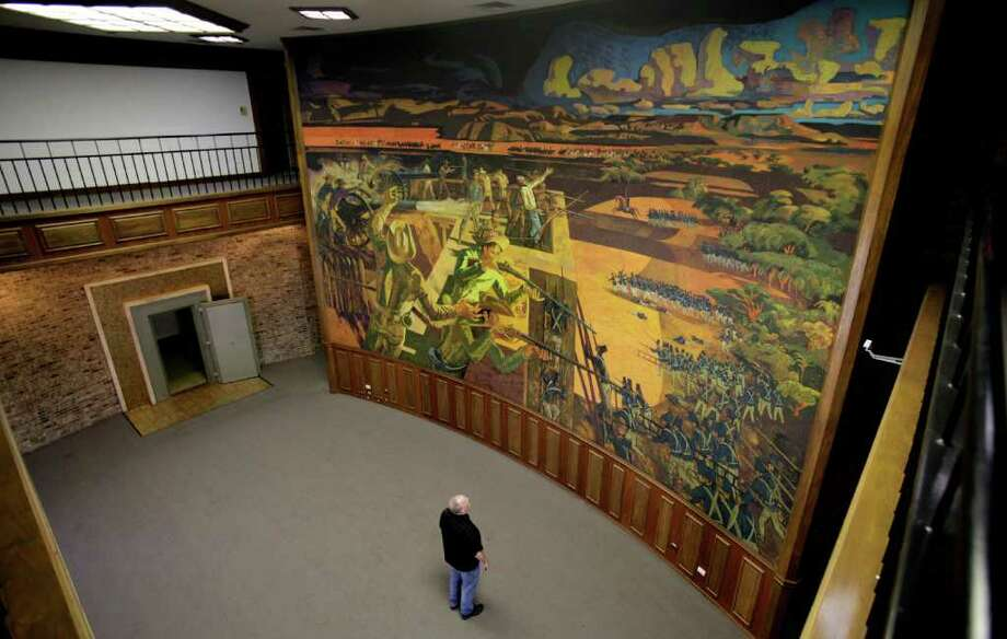 """The mural titled """"The Death of Travis"""" is in the old Travis Savings and Loan building on Main Avenue. Photo: BOB OWEN, SAN ANTONIO EXPRESS-NEWS / rowen@express-news.net"""