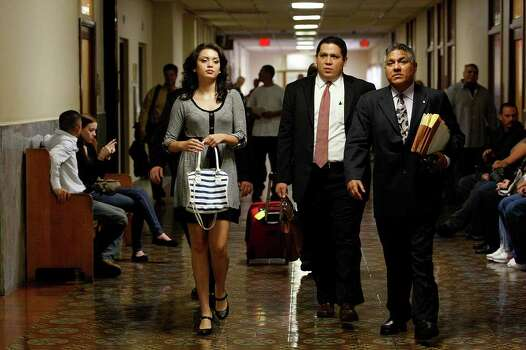 Domonique Ramirez, 17, and her attorneys, Santos Vargas (center) and Luis Vera Jr., head to court for a hearing on a request to extend an order barring the Miss San Antonio organization from naming the runner-up as queen. Photo: JERRY LARA, SAN ANTONIO EXPRESS-NEWS / glara@express-news.net