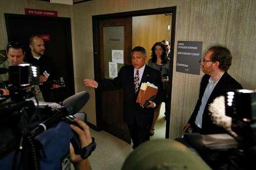 Domonique Ramirez and her attorney, Luis Vera, Jr., meet the media upon leaving the 224th District Court on Wednesday, Feb. 16, 2011. Photo: JERRY LARA, SAN ANTONIO EXPRESS-NEWS / glara@express-news.net