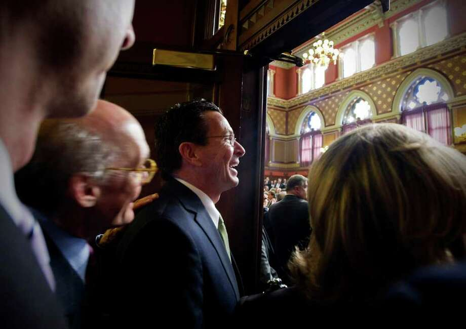 Governor Dannel P. Malloy prepares to enter the chamber to present his budget address to a joint session of the General Assembly in Hartford, Conn. on Wednesday, Feb. 16, 2011. Photo: Kathleen O'Rourke / Stamford Advocate