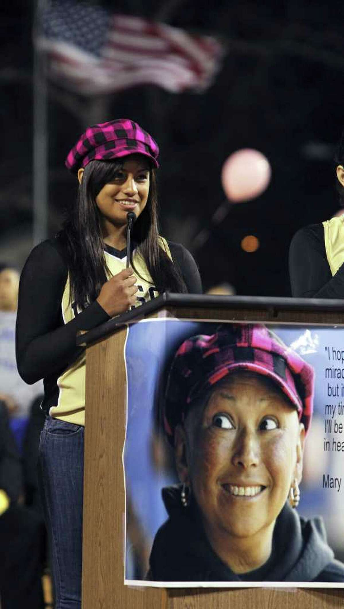 Edison softball player Lisa Vasquez shares words about her coach while wearing her hat as SAISD dedicates the Mary Ann Villarreal softball complex on February 16, 2011. Tom Reel/treel@express-news.net