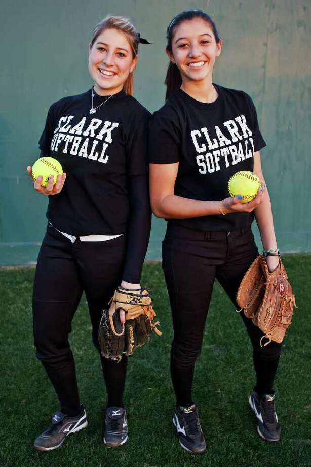 Clark's Megan Aragones (left) and Hennessey Soto will share duties on the mound for the Lady Cougars softball team this year. They're seen here preparing for a scrimmage against Judson at the North East ISD softball complex. Photo: Photo By Marvin Pfeiffer / Prime Time Newspapers 2011