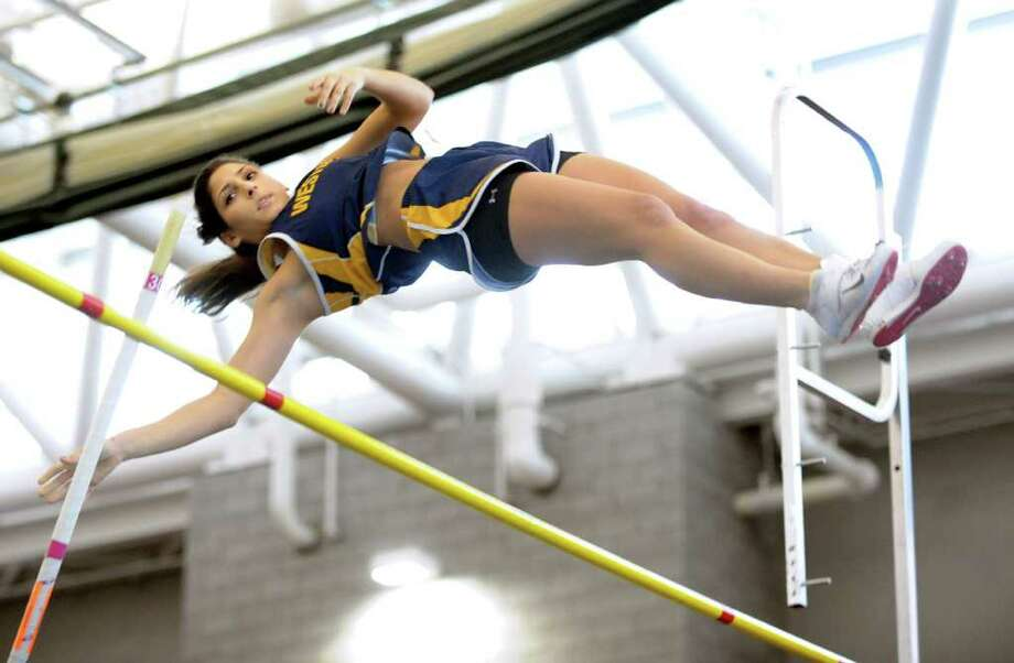 Weston's Kiki Litvak attempts to clear 10 feet, 6.5 inches in the girls pole vault event during the Class M track championship at the New Haven Athletic Center in New Haven, Conn. Saturday, Feb. 12, 2011.  Litvak took first place in the competition. Photo: Autumn Driscoll / Connecticut Post