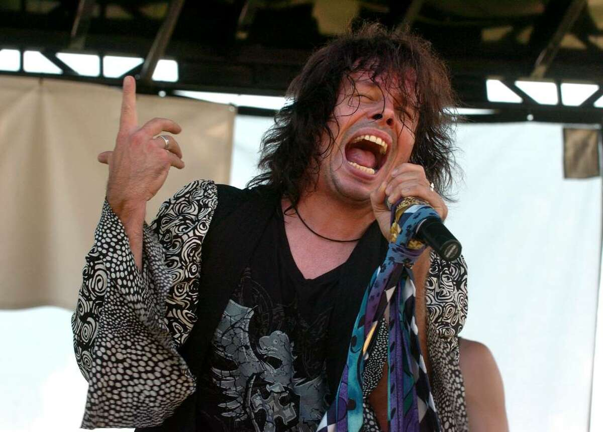 Christian Abraham/Staff photographer Neill Byrnes, of the Aerosmith tribute band Draw the Line, performs on the main stage during the Milford Oyster Festival in downtown Milford, CT on Saturday August 15, 2009.