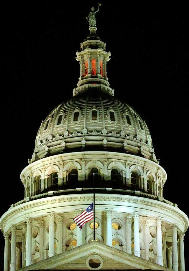 FOR METRO - The American flag, on the Texas Capitol in Austin, flies at half-staff in memorial of the seven astronauts that died aboard space shuttle Columbia Saturday Feb. 1, 2003. PHOTO BY EDWARD A. ORNELAS/STAFF Photo: EDWARD A. ORNELAS, SAN ANTONIO EXPRESS-NEWS / SAN ANTONIO EXPRESS-NEWS