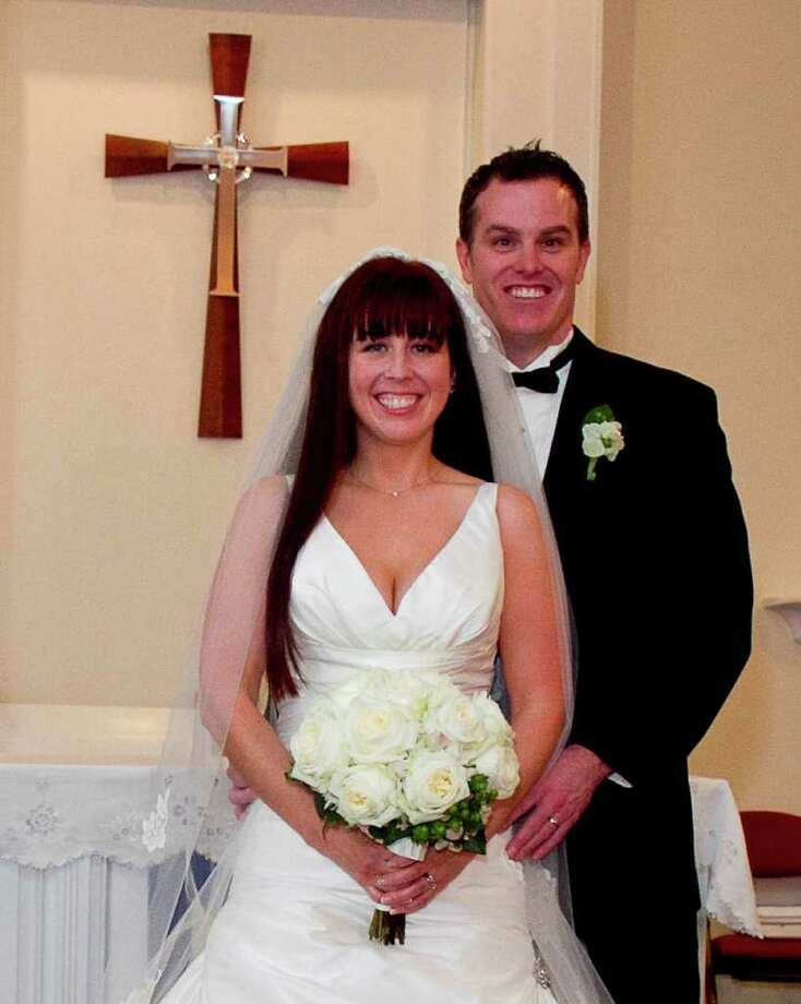 Amy Heather Swanson and Peter Gilbert Sillan were married on Dec. 4 at Our Savior's Lutheran Church in Fairfield. Photo: Contributed Photo / Fairfield Citizen contributed