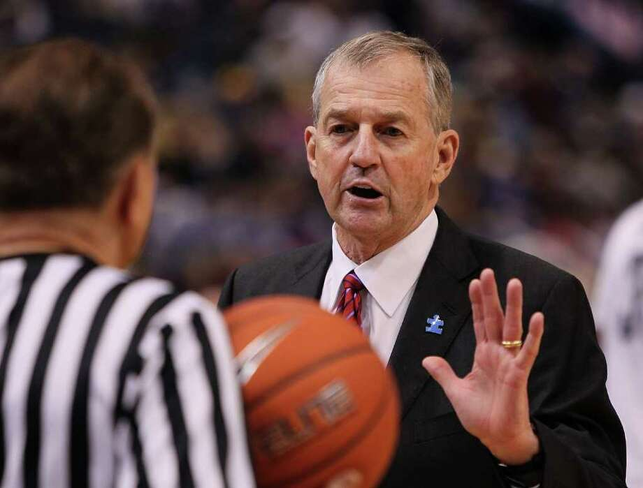 HARTFORD, CT - FEBRUARY 13: Coach Jim Calhoun of the Connecticut Huskies has words with an official during a game against the Cincinnati Bearcats at the XL Center on February 13, 2010 in Hartford, Connecticut. (Photo by Jim Rogash/Getty Images) *** Local Caption *** Jim Calhoun Photo: Jim Rogash, Getty Images / 2010 Getty Images