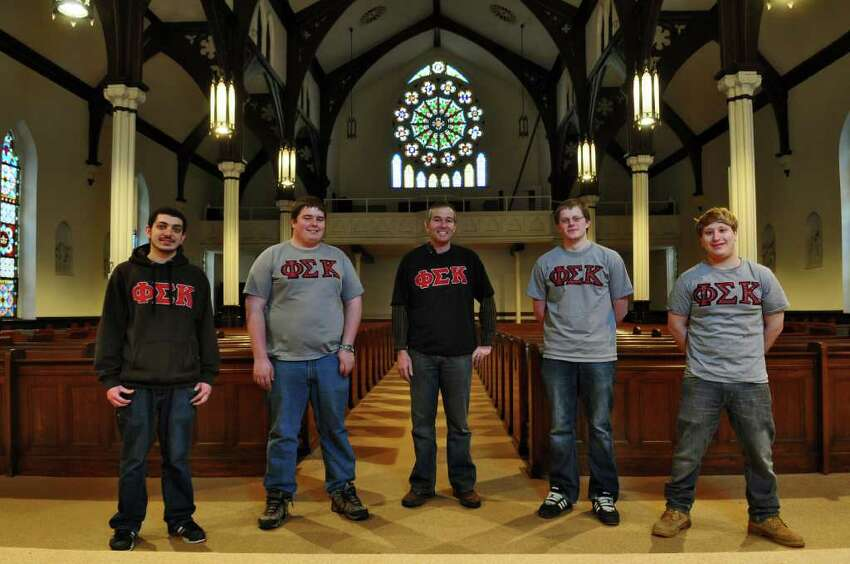 RPI students and Phi Sigma Kappa fraternity members, left to right, Justin Adibi, a junior from Medford, N.J.; Jim Frosell, a junior from Clarence, NY; fraternity adviser Paul Marano, an RPI 1987 graduate; Eric Otto, a senior from Traverse City, Mich.; and Ori Berger, a senior from Stanford, Calif.; inside of the former St. Francis de Sales Church purchased by the fraternity from the Roman Catholic Diocese of Albany, in Troy, NY, on Monday, Feb. 14, 2011. ( Philip Kamrass / Times Union )