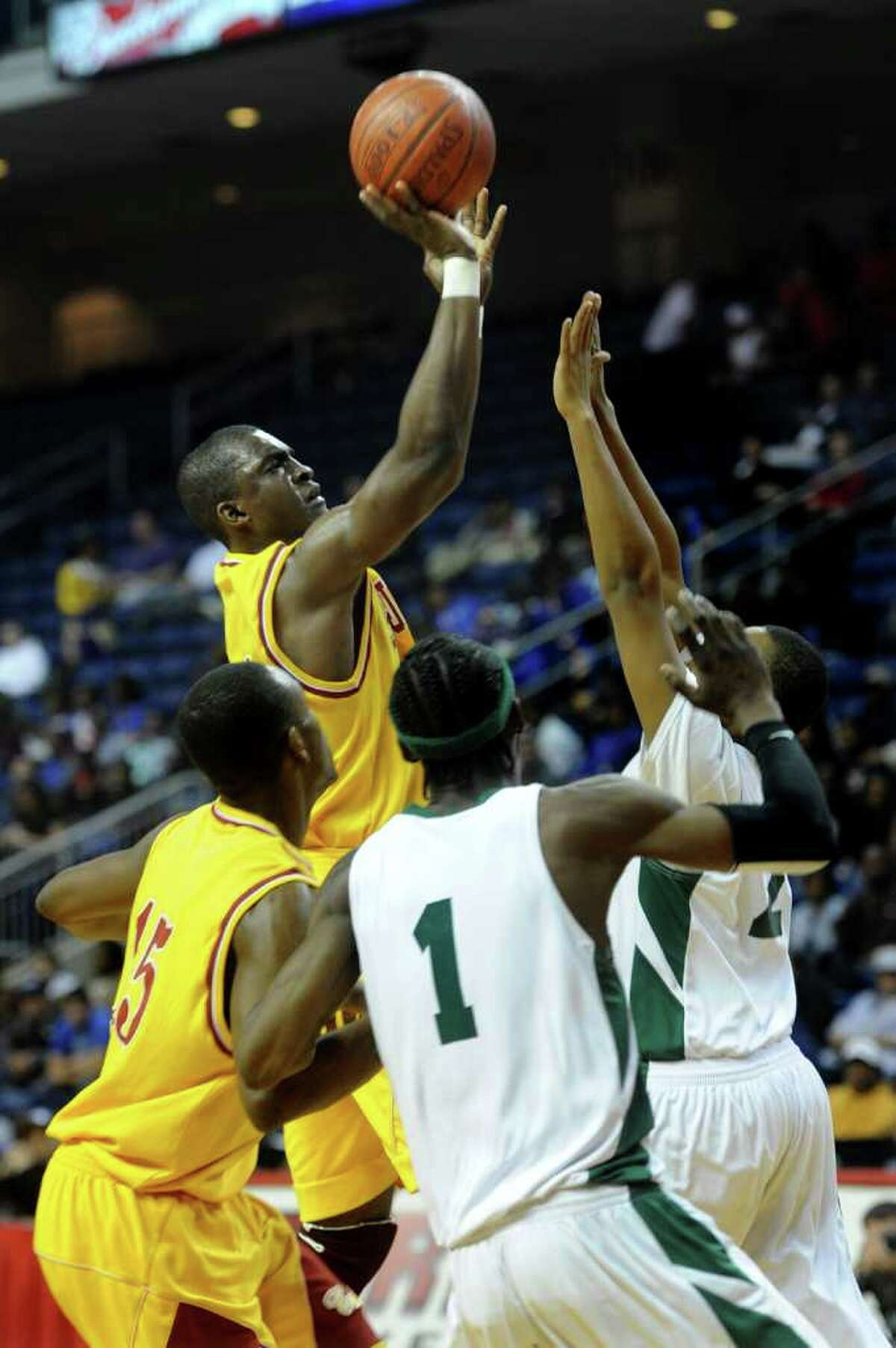 St. Joseph's Oscar Assie puts up a shot during Thursday's game at Webster Bank Arena at Harbor Yard on February 17, 2011.