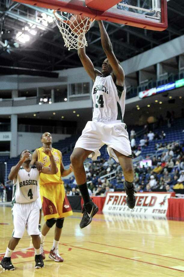 Bassick's Anthony Allen dunks the ball during Thursday's game at Webster Bank Arena at Harbor Yard on February 17, 2011. Photo: Lindsay Niegelberg / Connecticut Post