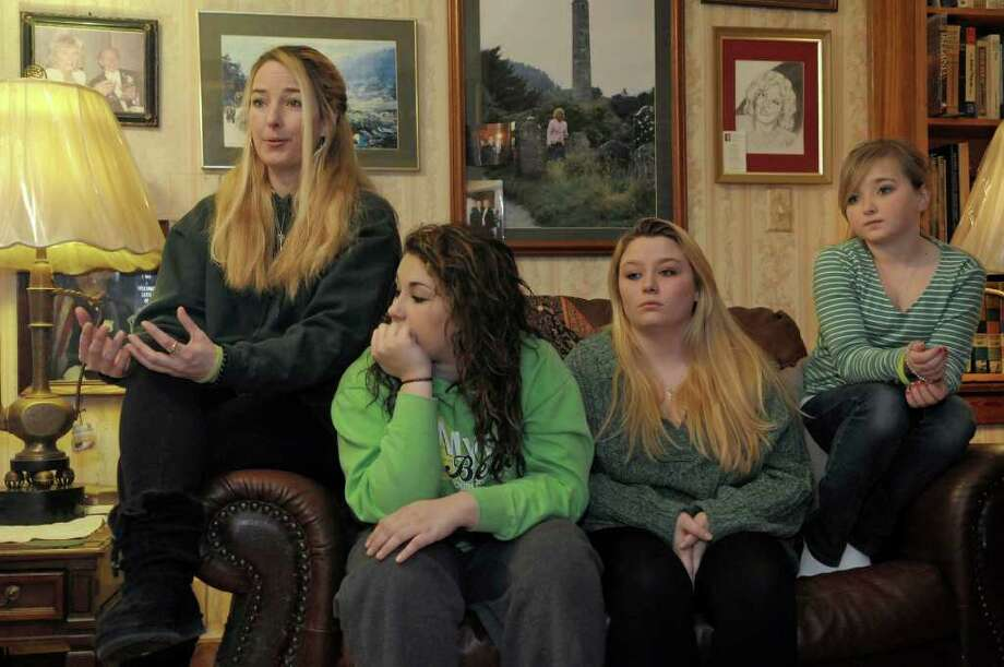 Patricia Burns, far left, talks about her daughter Christalin Canavan, who died suddenly and inexplicably on Dec. 27.  Seated at Christalin's grandparents home in Colonie are Burns, Christalin's best friend Acacia Rolon, 15, and two of Canavan's sisters, Megan Jenkins, 19, and Autumn Burns, 11.   (Paul Buckowski / Times Union) Photo: Paul Buckowski / 00011941A