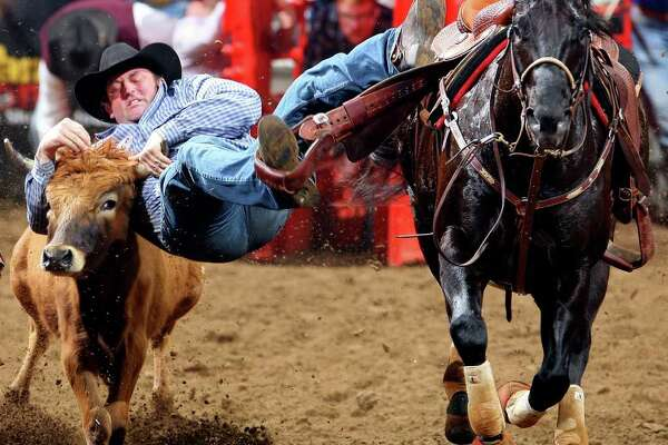 """Shane Henderson won his steer-wrestling round at Thursday's San Antonio Stock Show & Rodeo in 4 seconds and raised his earnings to $8,296.67, the most made by anyone to this point. """"It's unbelievable how good this rodeo has been,"""" the Winfield, Kan., cowboy said."""