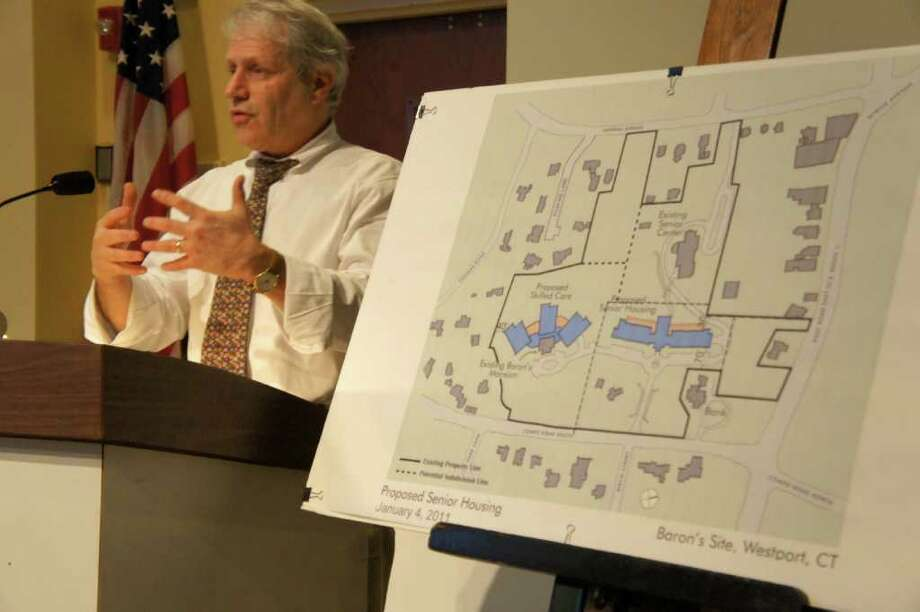 Richard Redniss, a land-use consultant on a plan to build a seniors' residential and care complex on the town's Baron's South property, outlines details of the project at a Planning and Zoning Commission meeting Thursday night. Photo: Paul Schott / Westport News