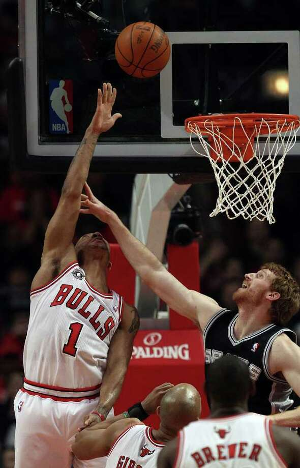 CHICAGO, IL - FEBRUARY 17: Derrick Rose #1 of the Chicago Bulls puts up a shot under pressure from Matt Bonner #15 of the San Antonio Spurs at the United Center on February 17, 2011 in Chicago, Illinois. NOTE TO USER: User expressly acknowledges and agrees that, by downloading and/or using this photograph, User is consenting to the terms and conditions of the Getty Images License Agreement. (Photo by Jonathan Daniel/Getty Images) *** Local Caption *** Derrick Rose;Matt Bonner Photo: Jonathan Daniel, Getty Images / 2011 Getty Images