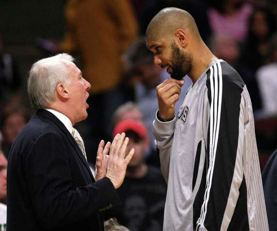 San Antonio Spurs head coach Gregg Popovich, left, talks with center Tim Duncan during the first half of an NBA basketball game against the Chicago Bulls, Thursday, Feb. 17, 2011, in Chicago. Photo: AP