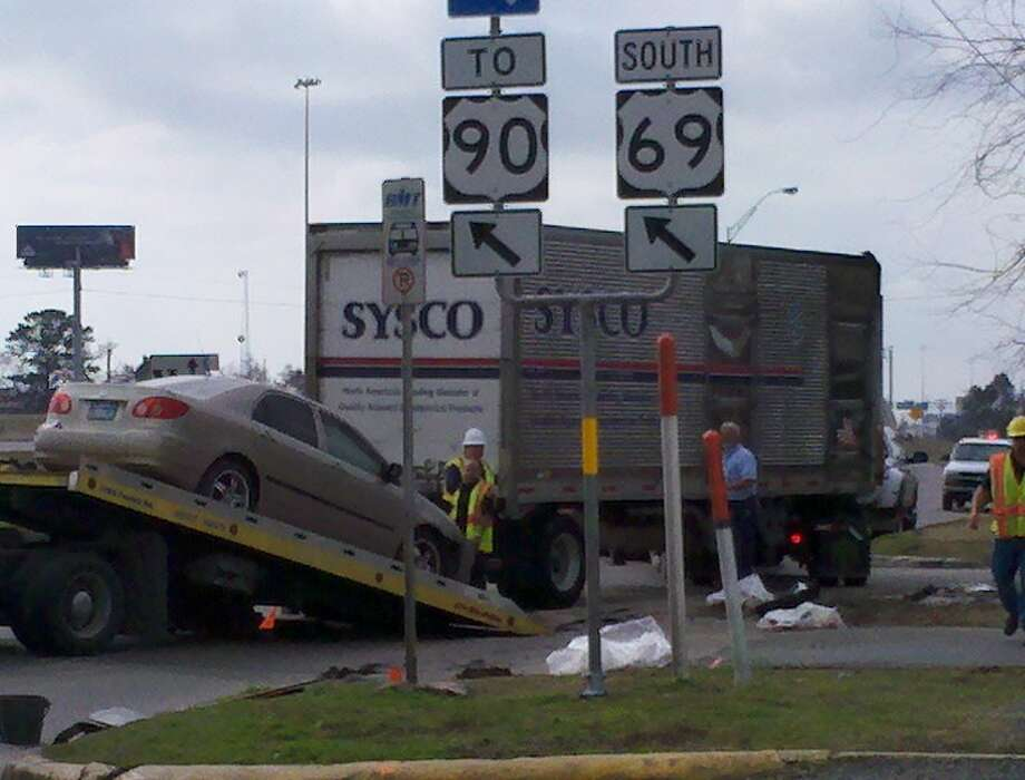 A Sysco food truck and a car were involved in an accident Friday morning that blocked traffic to the Laurel Avenue service road.  Teresa Mioli/The Enterprise