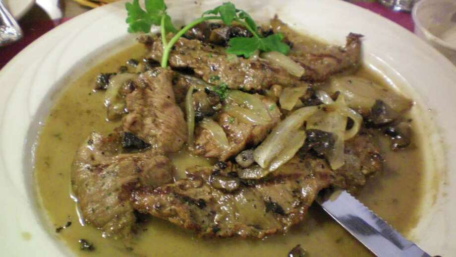 Tasty and affordable: London broil with portobello mushrooms, onions, balsamic vinegar in a lemon wine sauce at Pizza Palace on Black Rock Turnpike in Fairfield. Photo: Contributed Photo/Patti Woods / Fairfield Citizen contributed