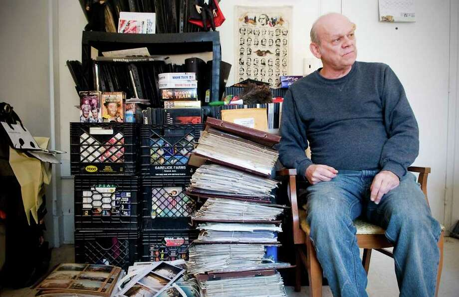 Tom Kessel sits in his apartment surrounded by photo albums filled with pictures he has taken of Stamford over the past 40 years in Darien, Conn. on Friday February 18, 2011. Photo: Kathleen O'Rourke / Stamford Advocate