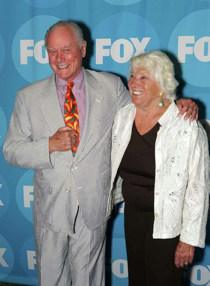 "Larry Hagman, left, of ""Nip/Tuck,"" and his wife Maj Axelsson, right, pose for photographers before FOX's Summer Send Off Party, Tuesday, July 25, 2006, in Pasadena, Calif. Photo: RENE MACURA/STR, AP / AP"