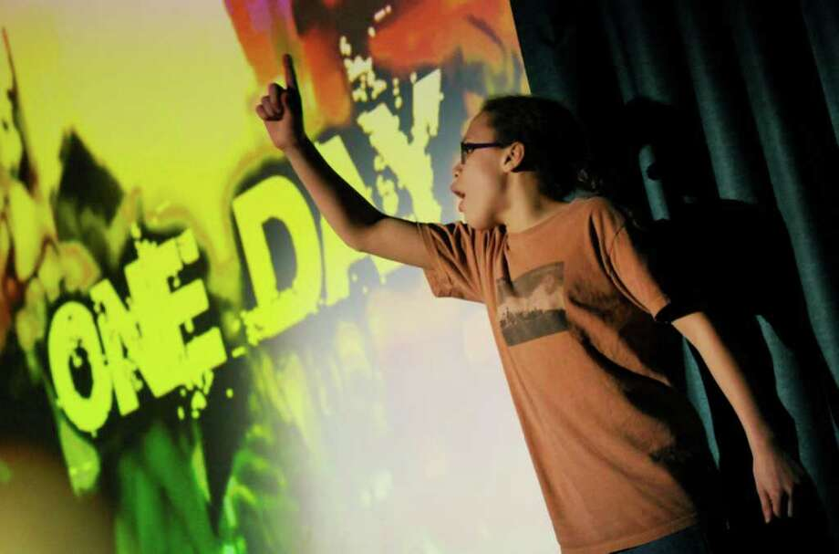 "Fifth-grade student Barbra Delany performs ""One Day"" by Matisyahu during the 2011 Thomas O'Brien Academy of Science and Technology's Black History Celebration Assembly in Albany Friday, Feb. 18, 2011. ( Michael P. Farrell/Times Union ) Photo: Michael P. Farrell"