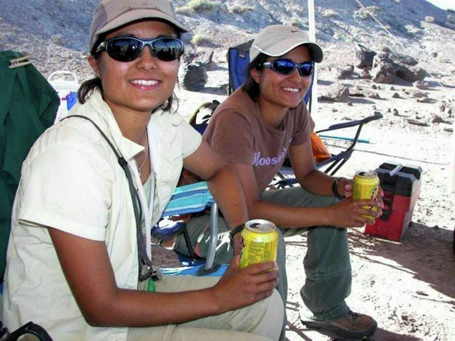 Marina (left) and Celina Suarez, twin sisters and geologists, take a break at the dinosaur boneyard they discovered in Utah in 2004. COURTESY PHOTO Photo: COURTESY PHOTO