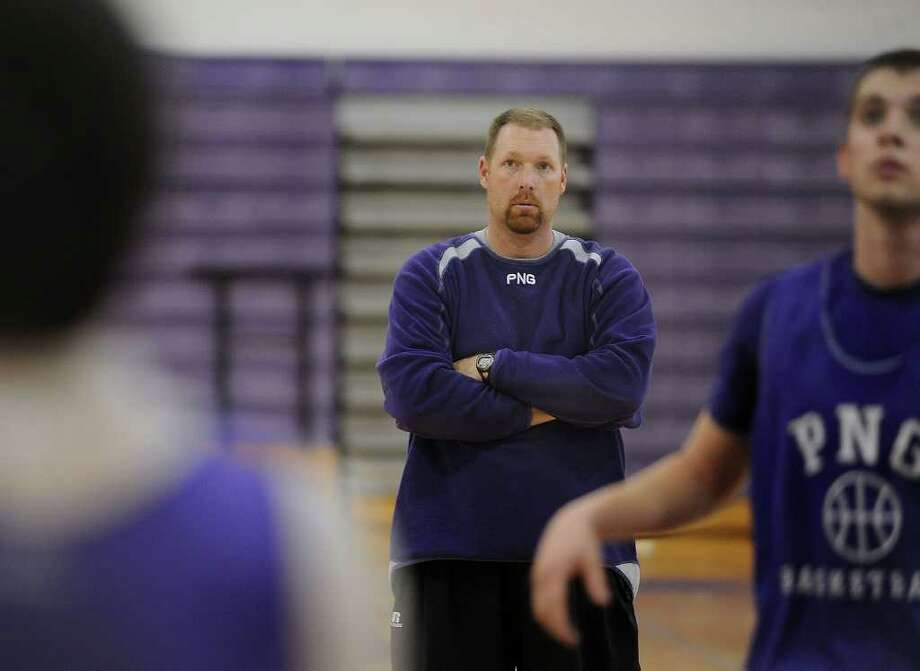PN-G's Pat Abel works his team during practice at the Indian's gym on Wednesday. Guiseppe Barranco/The Enterprise Photo: Guiseppe Barranco / Beaumont