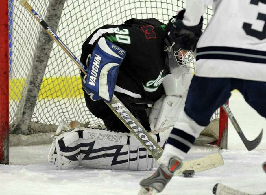 Norwalk goalie Daniel Diaz deflects the puck during boys hockey action against Staples in Milford, Conn. on Thursday February 17, 2011. Photo: Christian Abraham / Connecticut Post