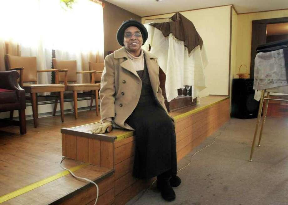 Lucia Nova poses inside the building on Ten Eyck Ave. in Albany, NY that she would like to move her church into.  Photograph take on Thursday, Feb. 10, 2011.   (Paul Buckowski / Times Union) Photo: Paul Buckowski  / 10012023A