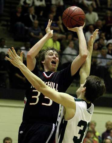 Churchill's Jacob Woods (33) takes a tough shot against Reagan's Brad Coulter (30) in boys basketball at Littleton Gym on Friday, Feb. 18, 2011. Reagan defeated Churchill in overtime, 71-64. Photo: KIN MAN HUI, Kin Man Hui/kmhui@express-news.net / San Antonio Express-News