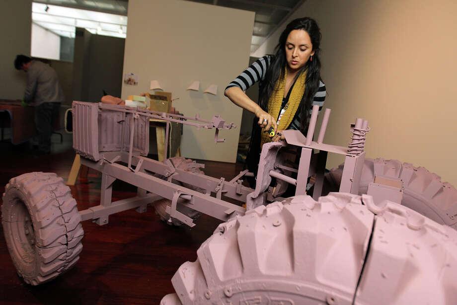 "Margarita Cabrera assembles her tractor, ""Arbol de la Vida (John Deere Model #790)."" JENNIFER WHITNEY / EXPRESS-NEWS"