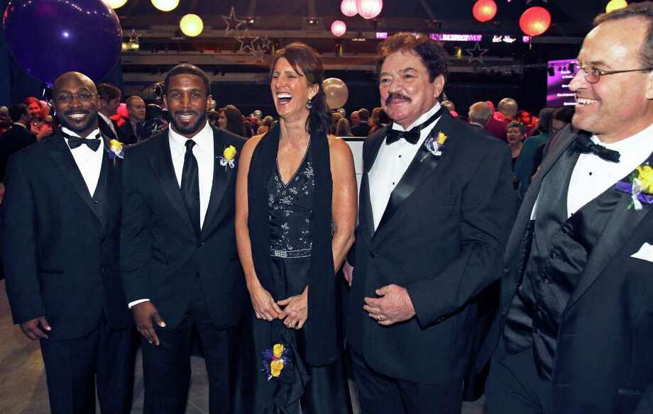 Jerod Douglas (from left), Priest Holmes, Laura Neugebauer Groff, Al Marks and Carl Gustafson — standing in for his late father, Marvin — gather during the S.A. Sports Hall of Fame induction at the Alamodome. Photo: TOM REEL, SAN ANTONIO EXPRESS-NEWS / © 2011 San Antonio Express-News