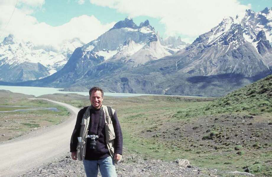 Documentary photographer Daryl Hawk, shown against the backdrop of mountains in the Patagonia region of South America, will give a slide show and lecture on the region in Westport March 9. Photo: Contributed Photo