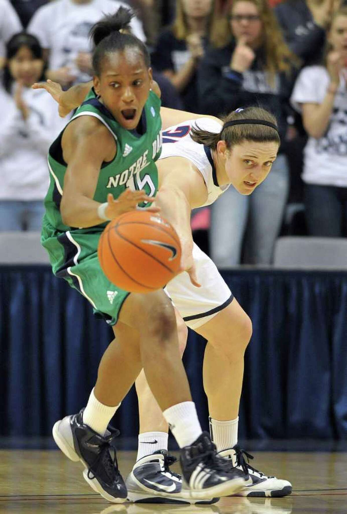 Connecticut's Kelly Faris, right, has the ball stolen by Notre Dame's Kaila Turner during the first half of an NCAA college basketball game, in Storrs, Conn., Saturday, Feb. 19, 2011. (AP Photo/Jessica Hill)