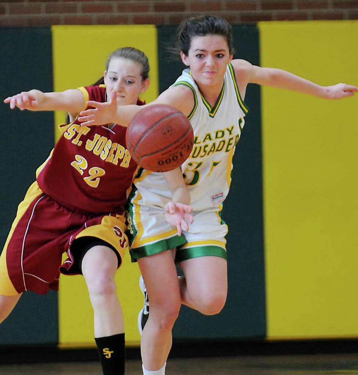 St. Joseph's Nancy Stablein and Trinity Catholic's Nicole Fay battle for control of the ball in girls basketball FCIAC quarterfinals at Trinity in Stamford, Conn. on Saturday February 19, 2011. St. Joseph beat Trinity 44-41.