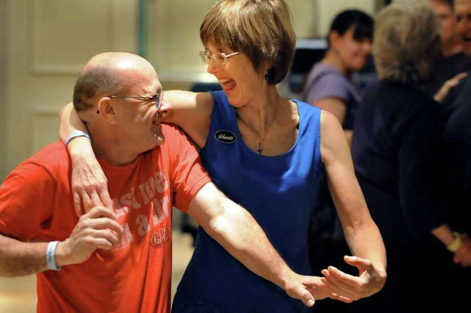 David Kauffman, left, and Shanti Kengeter, both of Philadelphia, dance at the Cajun Dance Party during the Flurry on Saturday, Feb. 19, 2011, at Saratoga Springs City Center in Saratoga Springs. The Flurry continues Sunday.  (Cindy Schultz / Times Union) Photo: Cindy Schultz