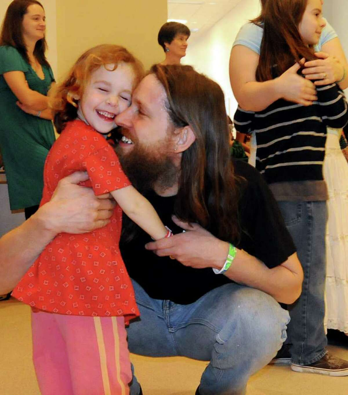Nadia Tell, 4, of Albany hugs her dad, Robin, after they dance together at Swing Dance for Kids during the Flurry on Saturday, Feb. 19, 2011, at Saratoga Springs City Center in Saratoga Springs. It continues Sunday. (Cindy Schultz / Times Union)
