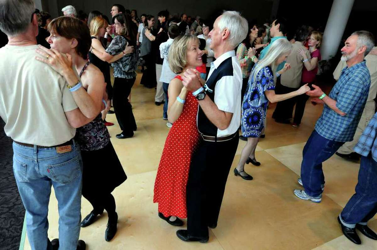 Mary Fellows of Delmar, center, dances with her husband, Gary Mehlum at Zydeco dance for beginners during the Flurry on Saturday, Feb. 19, 2011, at Saratoga Springs City Center in Saratoga Springs. It continues Sunday. (Cindy Schultz / Times Union)