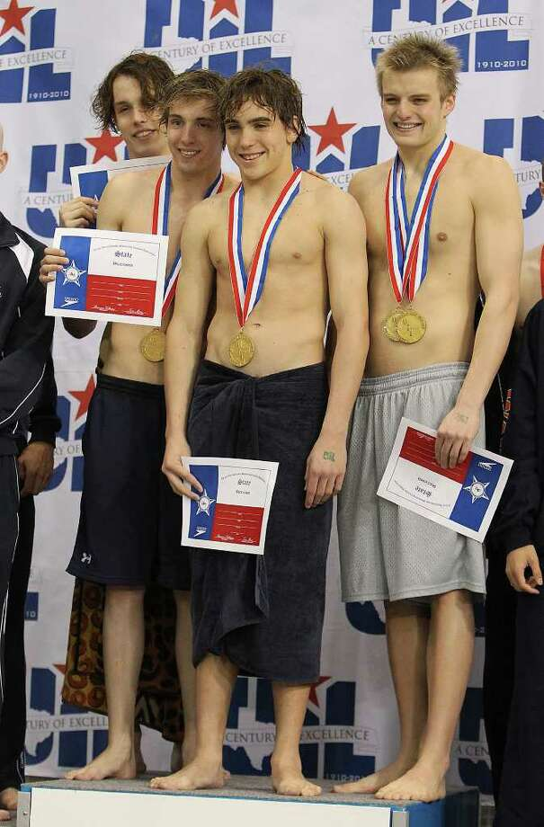 The Alamo Heights team of Ian Lemaistre, Adam Thomas, Austin Frey and Luke Shaw pose for pictures after they gold in the 200-yard freestyle relay at the 2011 UIL Swimming and Diving State Championships at Jamail Texas Swimming Center at the University of Texas in Austin on Saturday, Feb. 19, 2011. Photo: KIN MAN HUI, Kmhui@express-news.net / San Antonio Express-News
