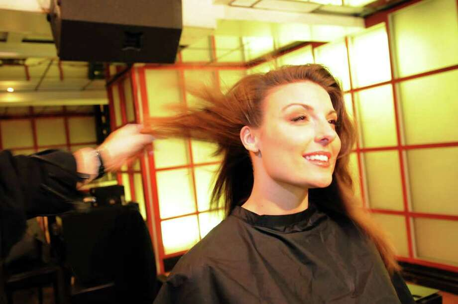"Actor Natalie Bain gets her hair done before filming the web series ""Bottle Service"" on Saturday, Feb. 19, 2011, at Mare in Saratoga Springs, N.Y. (Cindy Schultz / Times Union) Photo: Cindy Schultz"