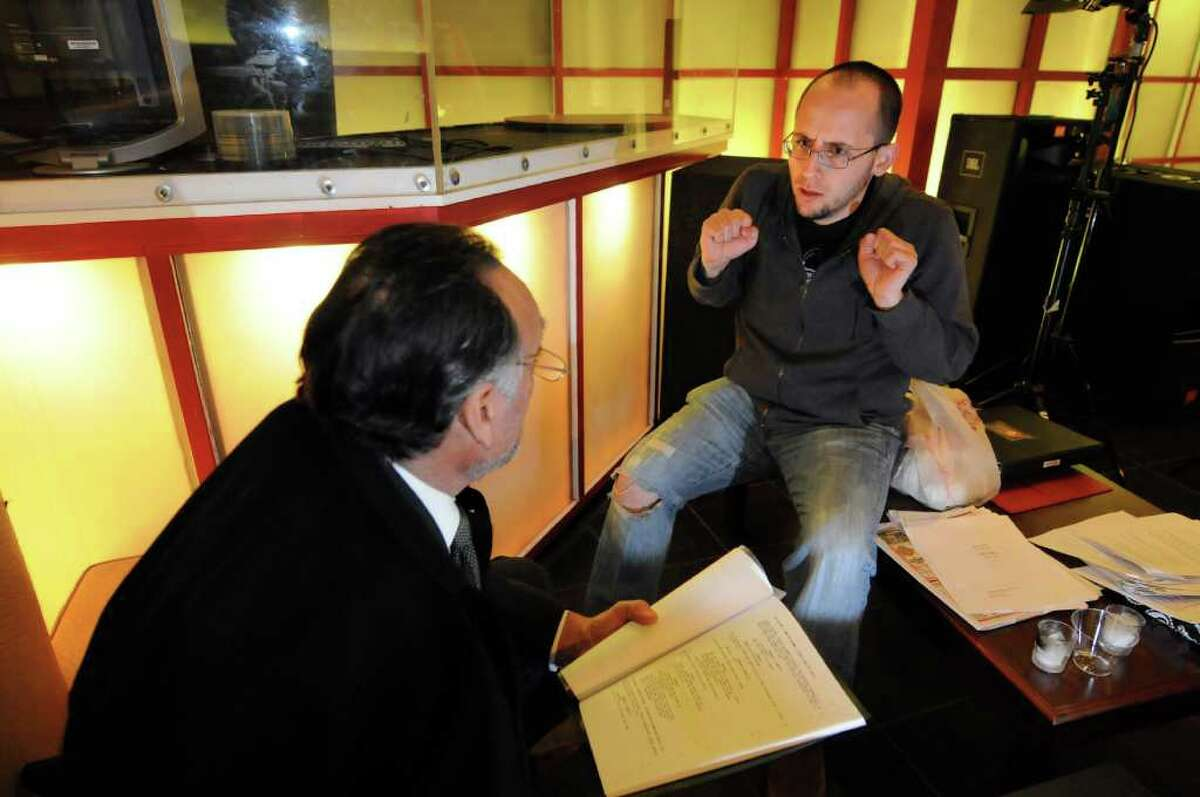 Director Juan Luis Lopez Fons, right, works with actor Giovanni Grillo before filming the web series