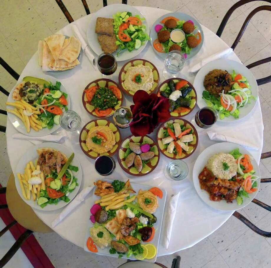 A selection of main dishes and appetizers at Al-Baraki in Cohoes (Michael P. Farrell / Times Union) Photo: Michael P. Farrell / 10012080A
