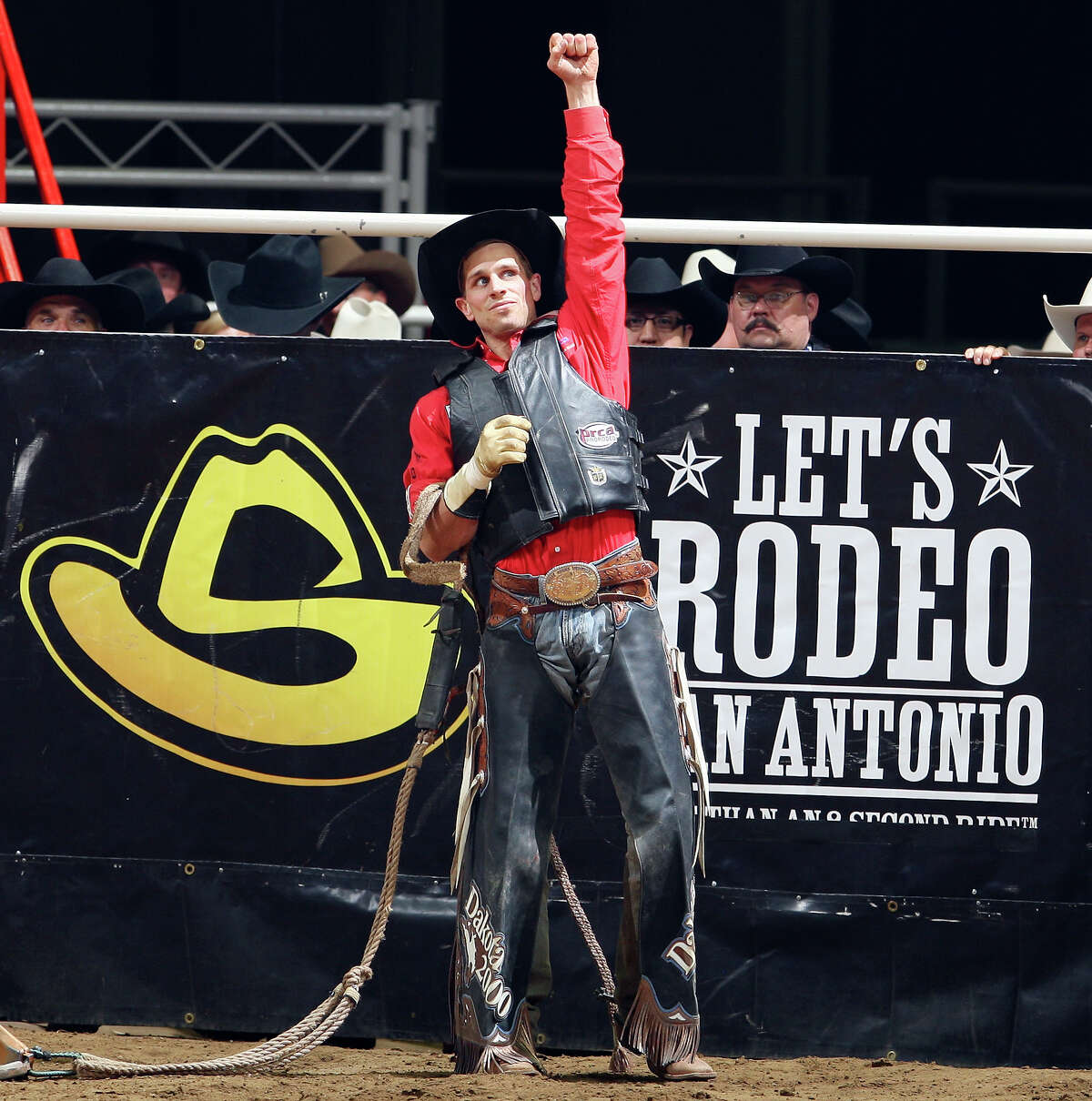 Ardie Maier, from Timber Lake, SD, celebrates after his bull ride Saturday Feb. 19, 2011 during the San Antonio Stock Show & Rodeo at the AT&T Center. Maier scored a 92 on the ride and won the event.