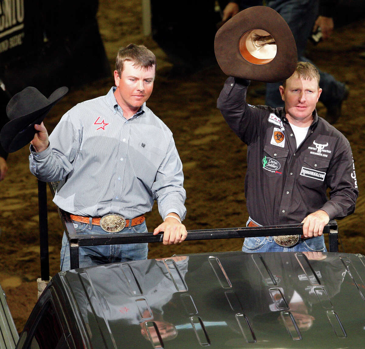 Jade Corkill, from Fallon, NV, (left) and Chad Masters, from Clarksville, TN, celebrate their win in the Team Roping event Saturday Feb. 19, 2011 during the San Antonio Stock Show & Rodeo at the AT&T Center.