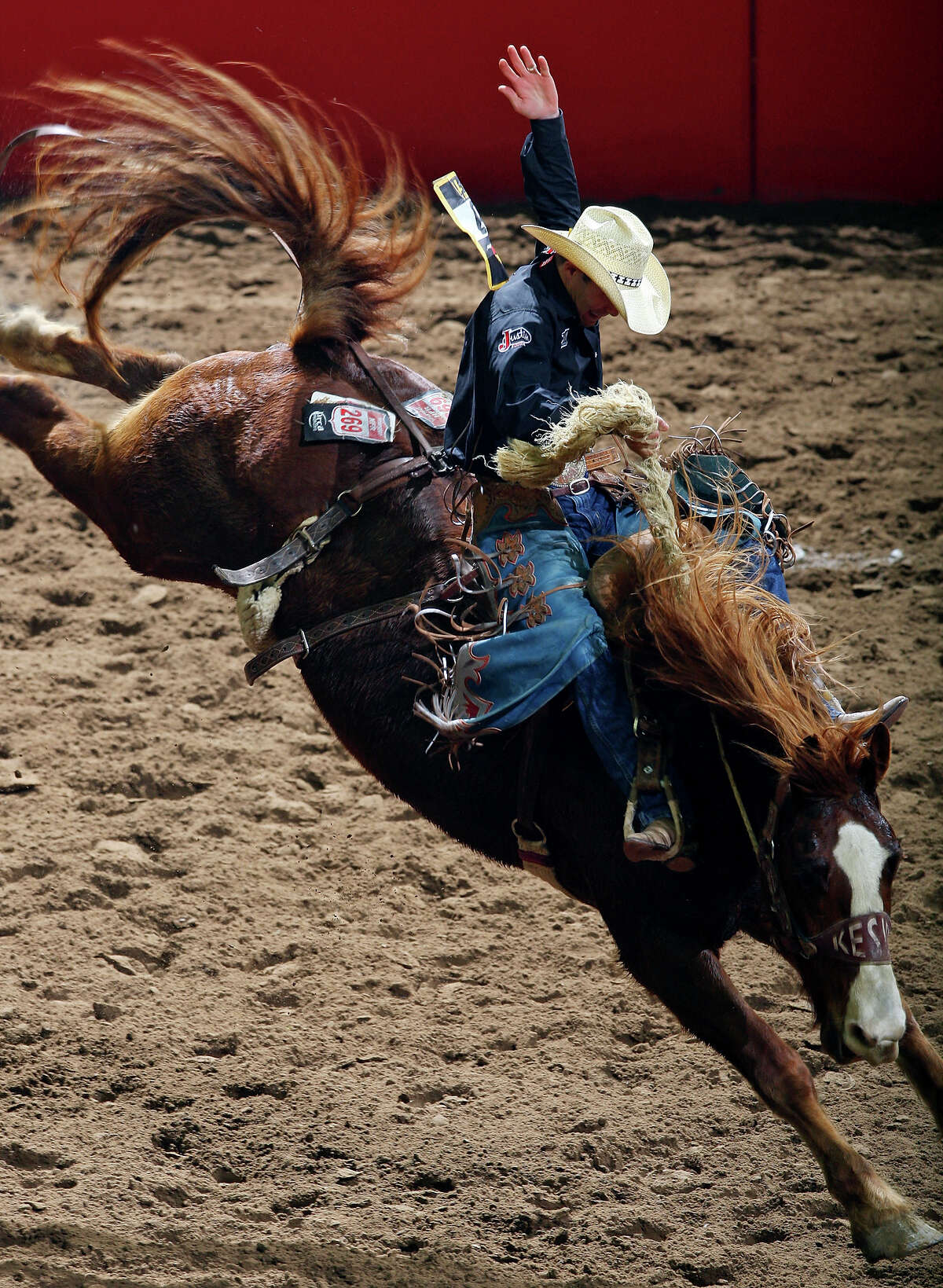 Heith DeMoss, from Helfin, LA, competes in the Saddle Bronc Riding event Saturday Feb. 19, 2011 during the San Antonio Stock Show & Rodeo at the AT&T Center. DeMoss scored an 88 on the ride and won the event.
